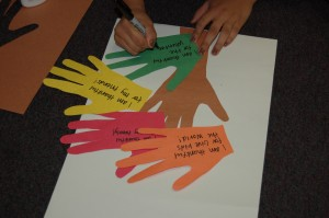 5. Using marker, write one thing you are thankful for on each hand.