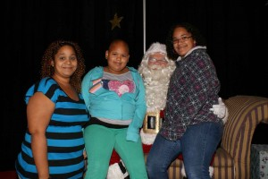 Ariangely and her family enjoy a visit with Santa during their wish trip to GKTW in October of 2011.