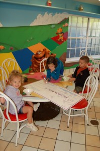 Faith, Gabbi, and Jackson filling out their donation check for GKTW.