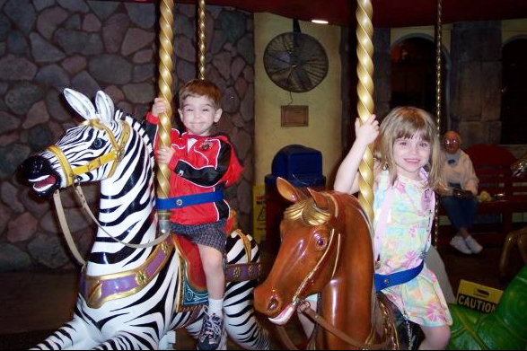 Mary and Aidan enjoy a ride on the Enchanted Carousel.
